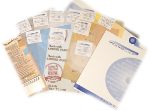 Sample pack containing siliconised greaseproof paper, tissue and grease resistant paper.