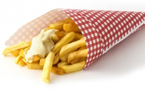 Printed grease resistant paper packaging of fish 'n' chips.
